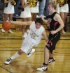 Sesar Bonilla of Billings West drives past Brandon Rydberg