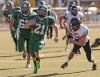 Central's Torry Huppert, 21, breaks free for a touchdown