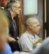Jason Burnett is wheeled into the Rosebud County courtroom