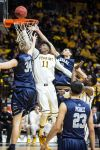 Wyoming uses rebounding, timely shooting to push past Nevada