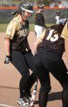 Ashley Davis celebrates a home run