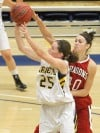 MSUB's Kalli Stanhope, 25, puts up a shot as Moorhead's Angie Jetvig, 40, defends
