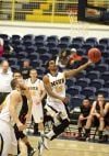 Devon Wallace of Montana State Billings slides into the lane