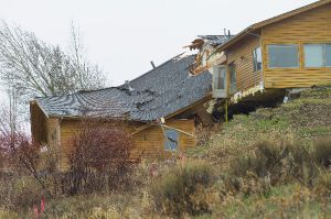 Looming, creeping landslide splits home in Jackson, Wyo.