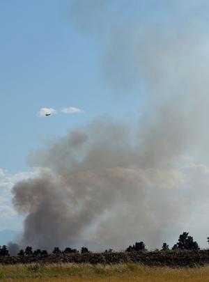 Multiple agencies battle fire northwest of Laurel