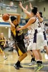Wyoming girls survive, beat Montana in OT 81-75