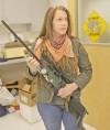 Kimberly Frank holds a dart gun