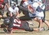 Huntley Project's Zach Tallon tackles Townsend's Zane McArthur