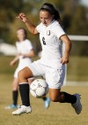 Senior's Michaela Kueffler brings the ball up the field