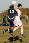West's Michael Kosmann, 10, and Great Falls'  Graham Owen, 17, battle for the ball