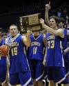 Scobey-Opheim players celebrate with the trophy Saturday night