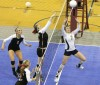 Carter Theade of Red Lodge sets a ball