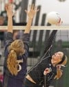 Central's Erika Kuehn, 5 spikes as Miles City's Kadie Heinle, 9, defends
