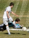 West's Koby Reyes, 9, gets a shot on goal as Great Falls'  goalie Zachery Conway, 14, defends
