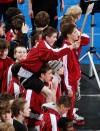 Helena High School wrestlers walk into the arena