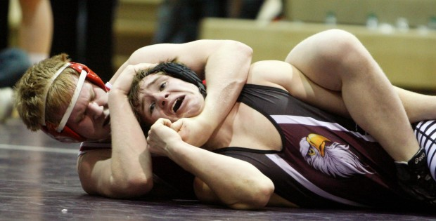 Tyler Kutzler of Glendive wrestles Doug Rooney of Sidney