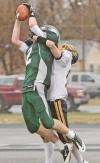 Central's Jacob Stanton, 2, makes a touchdown catch