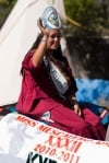 Miss Mescalero, Apache waves at the crowd