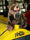 Toy bear on hood of 1925 Yellowstone touring bus