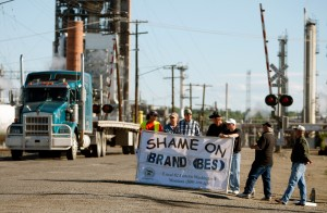 Displaced union workers hand out information at ExxonMobil refinery