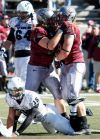 Johnson's 4 TDs lift Griz over PSU, 55-27