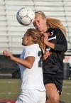 Senior's Blaque Saur (13) goes up for a header with West's Courtland Gleinig (2)
