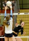 Sarah Dutro jumps to block Jessi Zuroff's spike