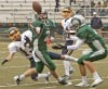 Central's Jacob Stanton, 2, and Miles City's Robert Nalewaja, 13, battle for a pass