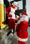 Santa helps Mrs. Claus