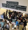 Travelers line up to go through TSA security