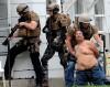 Billings police swat team members arrest a man