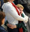 A young boy holds his mother