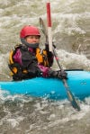 Sheila Tuss tries to navigate her kayak through a gate