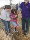 Emma Wissenbach, age 8, jumps on a shovel