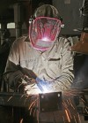 TrueNorth Steel's Logan Brown welds an end plate