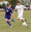 Senior's Karson White, 14, and Butte's Kenny Jense, 26, battle for the ball