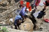 Princeton University researcher Evan Saitta unearths stegosaur plates