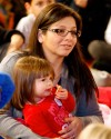 Monica Breyer sits with her daughter Gabriella