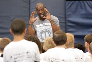Ex-NFL star Owens talks life lessons to football campers