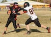 Huntley Project's Tanner Oblender, 3, is tackled by Plentywood's  Jackson Marsh, 86,