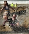 Participants splash into an obstacle