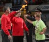 "Merle ""Buzz"" Toliver and Tom Hanel light a torch"