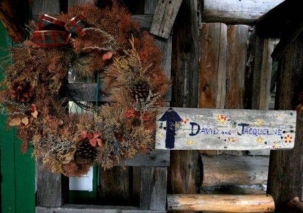 A wreath left over from last year hangs on the door