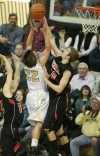 Lincoln Powers of Bozeman blocks a shot by Billings West's Ty Gilmore