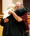 Ruel Blackman gets a hug from District Judge Mary Jane Knisely