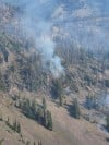 Miner Paradise Complex more than 25 percent contained