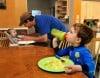 Jourdan Guidice serves breakfast to his sons