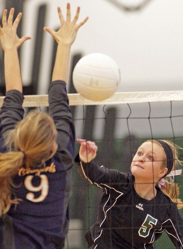 Central's Erika Kuehn, 5 spikes as Miles City's Kadie Heinle, 9, blocks