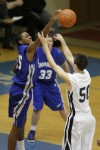 Cameron Evans of Skyview blocks a shot by Jace Anderegg
