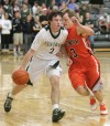 Central's Jacob Stanton, 2, brings the ball up court as Senior's Joe Zimmer , 3, defends